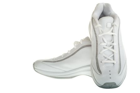 A pair of white basketball shoes isolated on a white background.