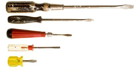 flathead: Five slotted or flathead screwdrivers isolated on white.