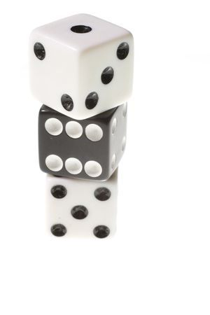 Three stacked die isolated on a white background