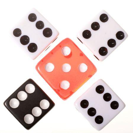 Five die arranged symmetrically.  Banco de Imagens