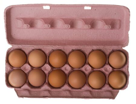 farmed: Looking down on a carton of a dozen brown farmed eggs. Stock Photo