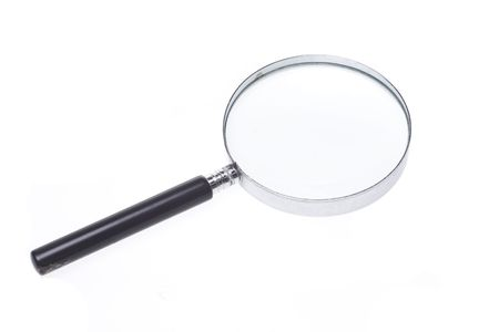 An old fashioned, generic, and rather plain magnifying glass isolated on a white background.