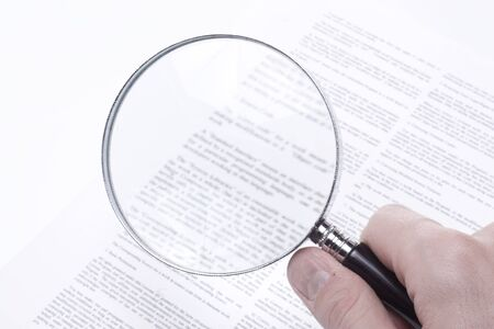 Confusing legal fine print on a business contract rendered blurred even with the aid of a magnifying glass.