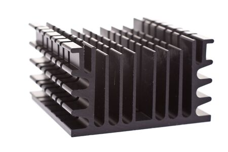 computer component: Close up on a computer component: a black heat sink, which dissaptes heat from the processor to keep the computer from melting.