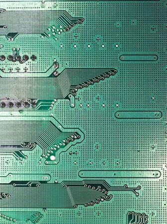 Background texture of a modern dark green circuit board background.