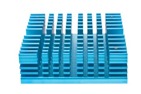 computer component: Close up on a computer component: a heat sink, which dissaptes heat from the processor to keep the computer from melting. Stock Photo
