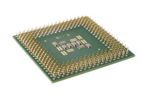 Looking at the bottom of a silicon microprocessor isolated ona a white background showing gold pins.