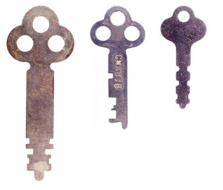 rusty background: Three old rusty worn keys isolated on a white background.  Stock Photo