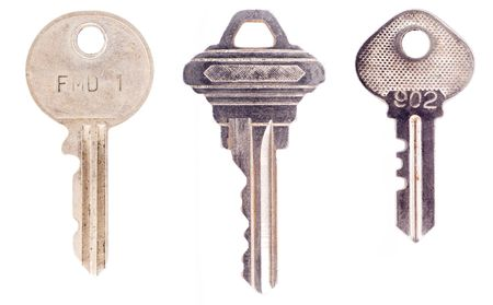 Three different, semi modern keys isolated on a white background.  写真素材