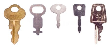 Five small luggage keys isolated on a white background.