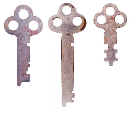 Three rusty weathered skeleton keys isolated on a clean white background.  写真素材
