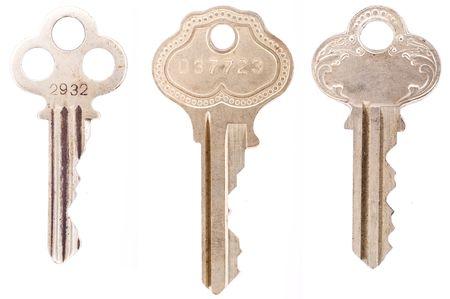 Three ornate vintage keys isolated on a white background.