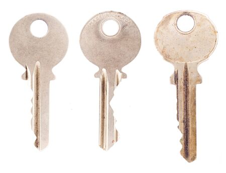 Three average office or house keys, isolated on a blank white background.