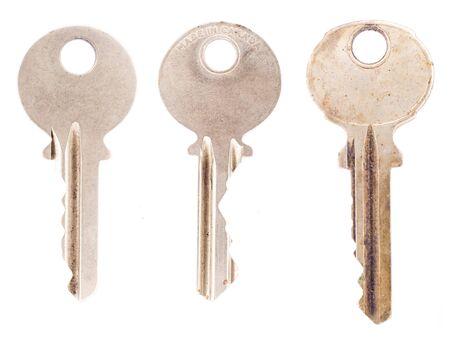 Three average office or house keys, isolated on a blank white background.  photo
