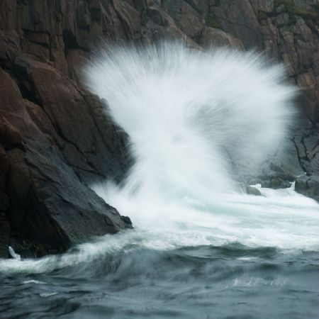 breaking in: Waves breaking in the gut, in Quidi Vidi Village, St. Johns, Newfoundland, Canada