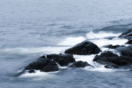 A long exposure of waves breaking below Fort Amherst, St. John's, Newfoundland, Canada 写真素材