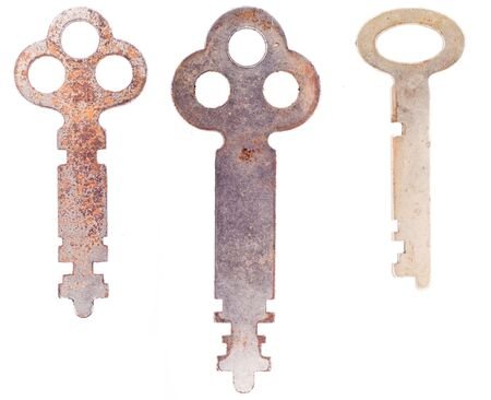 Three worn weathered skeleton keys isolated on a white background. 写真素材