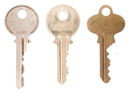Three old vintage average office or house keys isolated on a white background. 写真素材
