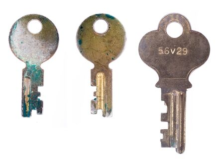 Three old rusty keys isolated on a white background.