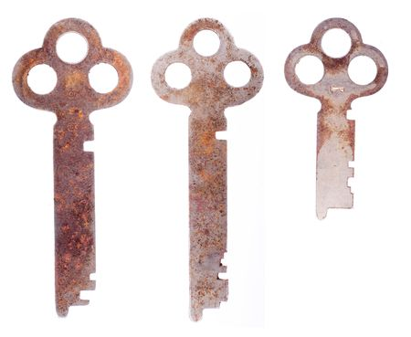 Three old keys isolated on a white background.