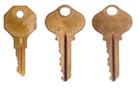 Three old office keys isolated on a white background.