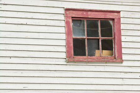 The window in a fishing shed near Fort Amherst, St. John's, Newfoundland, Canada. 写真素材