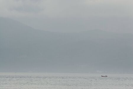 bonne: Lone fishing boat in Bonne Bay, Gros Morne, Newfoundland, Canada Stock Photo