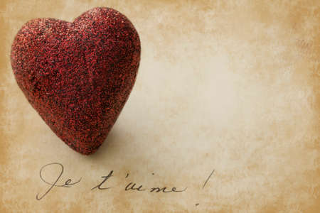 Shiny heart shape on grunge background, the words  I love you in French photo