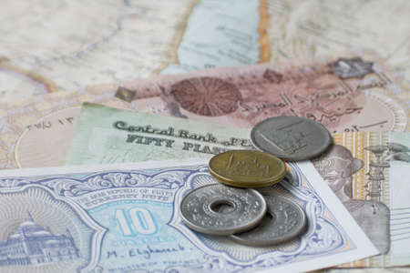 Egyptian coins and notes on map of Middle East photo