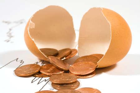 pennies: Broken egg with pennies Stock Photo