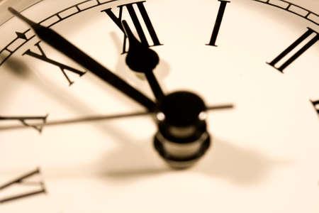 12 o'clock: Macro photo of clock face about to strike 12 o clock