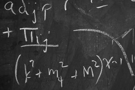 Closeup of partially erased numbers and writing on blackboard  photo