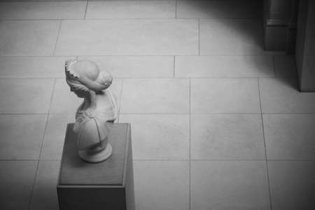 simulate: Classic head and shoulders marble carving with copy space  Grain added to simulate black and white film