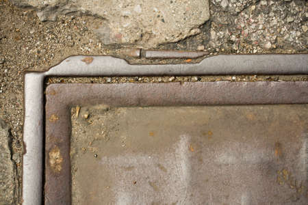Close-up image of grungy abstract metal manhole cover photo