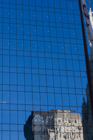 ade: Glass fa�ade of office building with reflection of another building Stock Photo