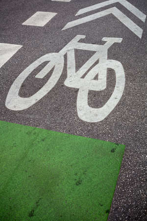bicycle lane: Bicycle lane painted on street surface, focus on bicycle