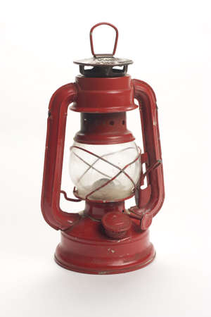 old kerosene lamp isolated over white background photo