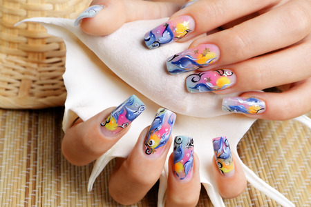 nail design: Female hands hold a seashell.