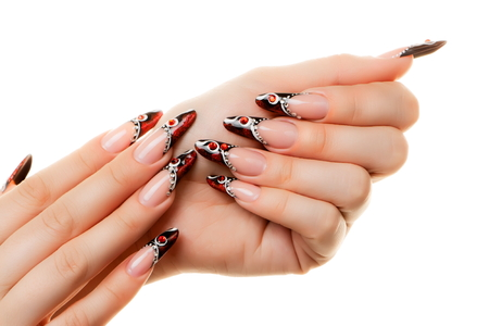 Red and black nail design. Isolated on white. Фото со стока