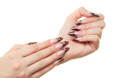 manicured: Red and black nail design. Isolated on white. Stock Photo