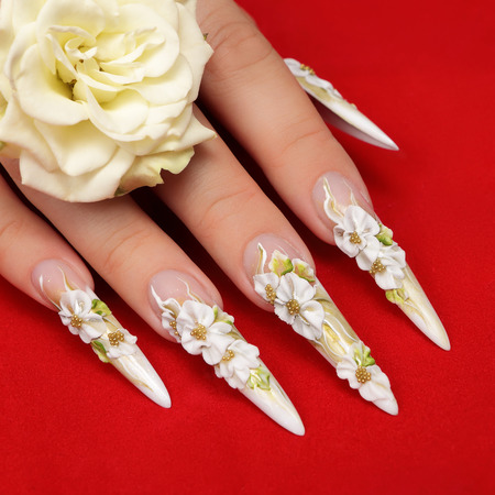 Beauty nail art design on a red background. 写真素材