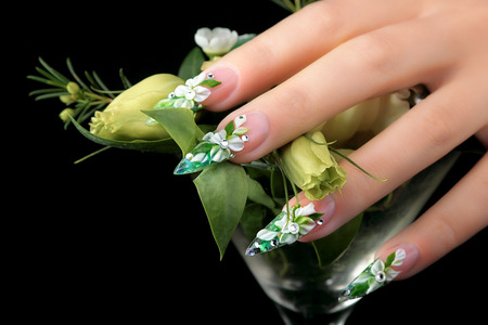 Design female nails a black background.