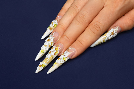Nail art design on a blue background.