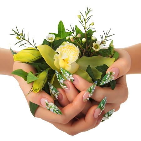 Hands holding a bouquet of flowers.Isolated