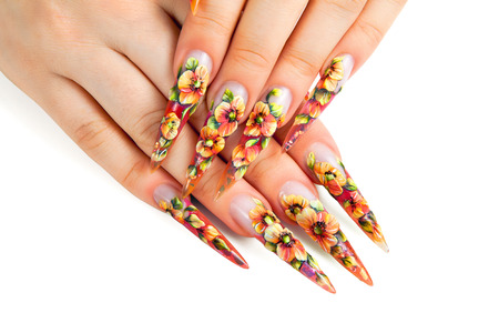 Beauty floral design nails on female hands.