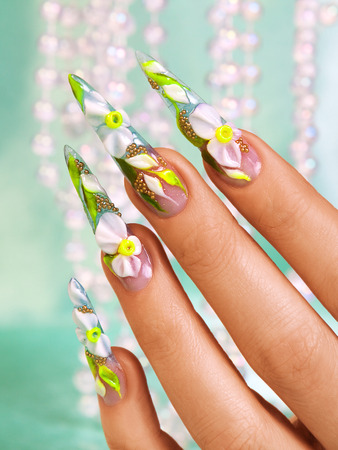 Beautiful floral art design on female nails.