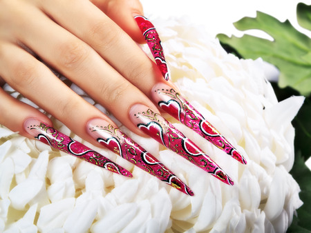 Female hand with red art design nails  . Stok Fotoğraf