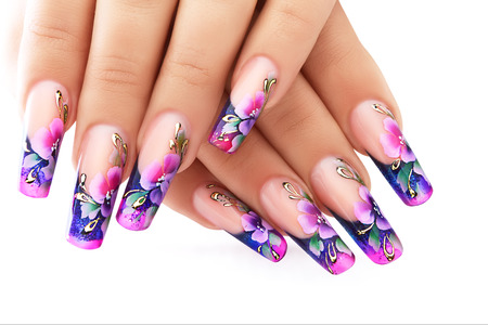 artificial nails: Female hand with floral art design nails  . Stock Photo