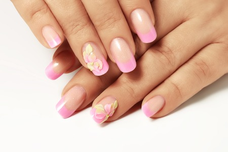 Pink nail polish on nails of women. Stok Fotoğraf