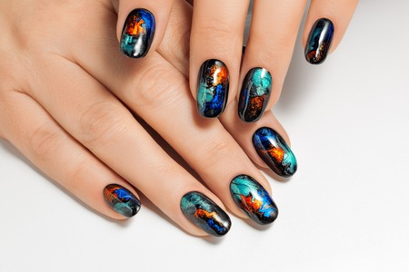 body painting: Womens hands with an abstract pattern on the nails.